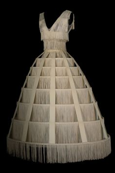 This Gaultier dress resembles the crinoline, which came into fashion at around and remained until the end of the century. The patterns and layering of the garments would change, but their volumes would remain similar. 2000s Fashion, Fashion Art, High Fashion, Fashion Show, Fashion Design, Jean Paul Gaultier, Hoop Skirt, Art Costume, Theatre Costumes