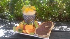 Mango, muesli and custard trifle with a garden of tangelo, kiwifruit and nectarine. Sided with an English muffin smothered in nuttela