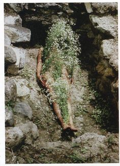 """Ana Mendieta, Imagen de Yagul, 1973. She has said, """"My art is the way I re-establish bonds that unite me to the universe. It is a return to the maternal source. Through my earth/ body sculptures I become one with the earth… I become an extension of nature and nature becomes an extension of my body."""" Ana Mendieta's Earth Body, Sculpture and Performance, 1972–1985"""