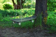 Extremely simple but certainly creative. Latvia based artist and photographer SmileyG, real name Margarita Germane, took this photo depicting a very worn out skateboard being used as swing. Two ropes wrap around the deck near the trucks, connecting to the tree providing a stylish swing set in this green garden.