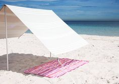 "<div><span style=""font-family: sans-serif;"">Want to hit the beach in style? Consider beach umbrellas a thing of the past. After all, who likes chasing after one on a windy day? This summer, we're all for reinventing our go-to beach essentials with a bit more form and functionality in mind. Enter the beach tent. This </span><i><span style=""font-family: sans-serif;"">domino</span></i><span style=""font-family: sans-serif;""> favorite is about as versatile as they come. Equipped with both..."