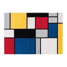 Style Mondrian pour ce tapis Arte Espina. Modèle Coloured cubes sur www.benuta.com.