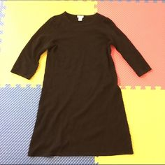 J Crew jcrew 100% Cashmere Black Sweater Dress M In great condition! Does have a small hole on the sleeve, can probably be patched or darned up. Great deal for a $300+ dress! 3 quarter sleeves. J. Crew Dresses