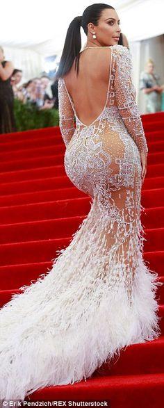 Kim Kardashian brings in the Spanx to wear tight split skirt #dailymail