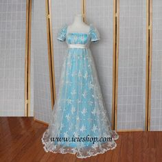 A reporoduction Regency Ball Gown ~ To be honest this lace is quite obviously a modern lace (and very typical of a modern day wedding dress overlay), but nevertheless it looks quite ethereal over that blue satin...