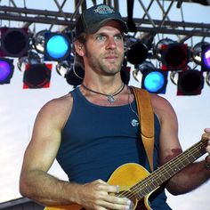 Billy Currington...something about a man w/ a guitar!!!