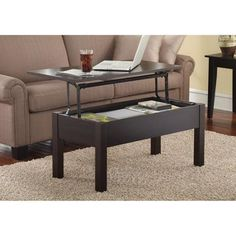 With the Mainstays Lift-Top Coffee Table you won't have to reach far to get what you need. This innovative espresso coffee table has a unique extending work surface that lifts up allowing you to eas...