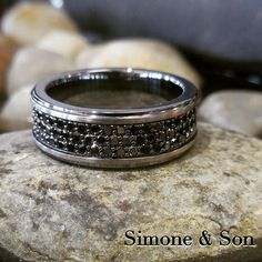 Check out this men's wedding band that we just finished up. 3 rows of micro pave set black diamonds! #diamonds #blackdiamonds #mensring #mensfashion #wedding #weddingring