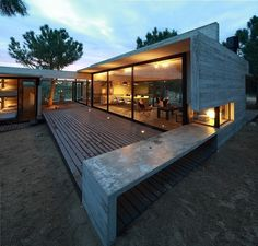 Casa Carassale - Modern concrete single family residence designed by BAK Arquitectos in 2012 situated in Buenos Aires, Argentina.