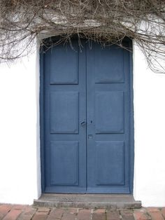 White walls, blue door