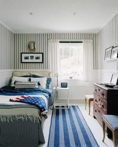 Bedroom decorating ideas for small rooms. Use stripes to make the room appear wider or longer.