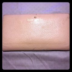 Nude Kate Spade wallet Nude Kate Spade wallet. Definitely has some ware. See photos. Ware is mostly on outside. kate spade Bags Wallets