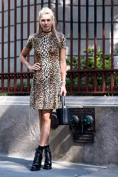 Take a walk on the wild side with a leopard-print dress and ever-chic black ankle boots like this New York Fashion Week attendee