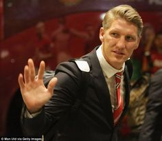 Bastian Schweinsteiger, who joined the club from Bayern Munich, waves to the supporters...
