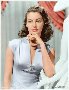 Stunning Ava Gardner. Presumably somewehere in the early 1940's. When women were ultra feminine.