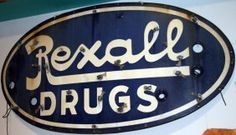 "REXALL DRUG STORE SIGN    Blue oval porcelain sign; neon tubes missing; some staining; few minor edge chips; 23"" x 48"", G-VG"