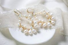 """Not your classic hoops! These stunning vine inspired Freshwater pearl hoop Bridal earringswith a hint of white opal Swarovski crystalsare an elegant touch to your bridal look.- Earrings measure 1.75"""" x 1.25""""- Freshwater pearls- White opal Swarovski crystals- Available in gold, rose gold or rhodium finish- Handcrafted Gold Bridal Earrings, Bridal Jewelry Sets, Bridal Necklace, Wedding Earrings, Wedding Jewelry, Pearl Earrings, Wedding Accessories, Swarovski Crystals, Just For You"""