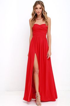 You'll be admired as soon as you set foot in the party wearing the Moonlight Serenade Red Strapless Maxi Dress! Draping woven poly fabric adorns a strapless sweetheart neckline with lightly padded cups and no-slip strip. A gathered waist introduces a full, maxi skirt with sexy side slit. Hidden back zipper and clasp.