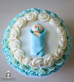 Easy baby shower cake with fondant baby topper.Great for gender reveal party.