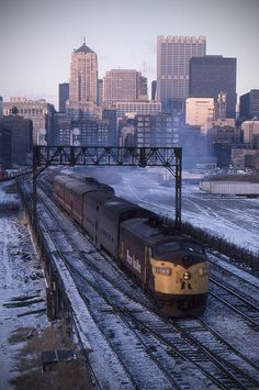 CRI&P F-unit number 675 leads train from LaSalle Street Station, Chicago, Illinois. The Chicago Board of Trade Building is conspicuous in the background. This image was made by Richard Koenig on December 22nd 1976.