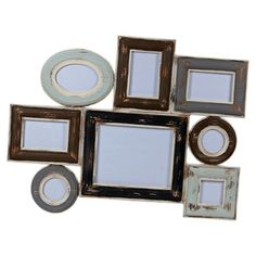 Multicolor wood wall picture frame. Holds eight pictures.  Product: Picture frame clusterConstruction Material: ...