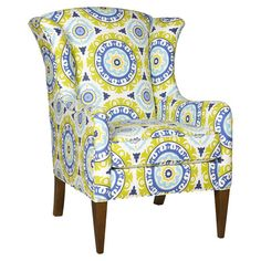 Wingback accent chair with medallion motif. Made in the USA.   Product: ChairConstruction Material: Wood and fabr...