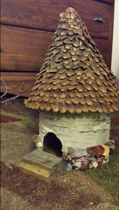 Fairy House for our fairy garden. Summer project for the Little and I to do. Collected birch bark, pine cone shutters, tumbled found stones, cardboard, bottom of a gallon vinegar bottle, and a found piece of wood.