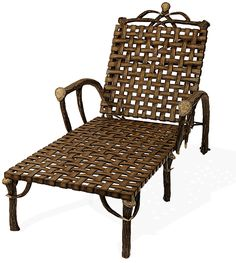 Antler Chaise - A large and comfortable chaise for lounging around the pool or deck, the hand cast aluminum 'Elk antler' and 'woven leather' chaise has subtle wheels for mobility and an adjustable back rest.