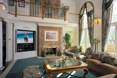 Remote Control Great Room With High Ceiling And Stony Fireplace | EDGonline