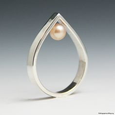 Love this because it's different. inverted pink pearl ring - My Engagement Ring