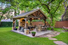 Check out this beautiful outdoor patio design. The entire renovation is done with the stylish and graceful pattern. The adorable rustic charm is added to this design with the fascinating fireplace arrangement and with the creation of the lovely gazebo as well. The shining yellow lights are also making this idea fabulous.