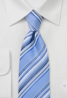 Tie made of microfibres with fine stripe structure in cool icy blue. This tie is hand-made canvas, cut into shape and sewn by hand. The elastic inner lining makes sure the tie straightens out again after each wear. http://www.mens-ties.org/stripes-blue-p-13209.html