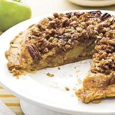 Apple Upside-Down Pie | A buttery mix of brown sugar and pecans caramelizes as it bakes beneath the bottom crust of this upside-down #applepie. | SouthernLiving.com