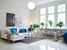 Put spare white and black print leaning in front of Jamie's painting                                                        22 Stylish Scandinavian Living Room Design Ideas