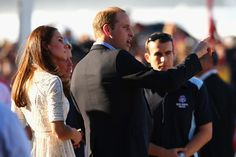 Kate Middleton Prince William, Duke of Cambridge and Catherine, Duchess of Cambridge talk to surf life-savers at Manly Beach during a surf l...