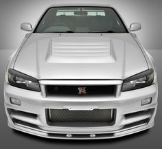 I want one SO BAD!  I am even willing to learn to drive and shift from the wrong side of the car!  Nissan Skyline GT-R34
