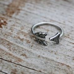 House of Harlow 1960 Arrow Ring House of Harlow 1960 Silver Arrow Affair Ring, Size 5 Features:  Ring in bent arrow design featuring glass stone-embellished ends.  MetalBase MaterialGlass Width1.4 millimeters Length8.2 millimeters House of Harlow 1960 Jewelry Rings