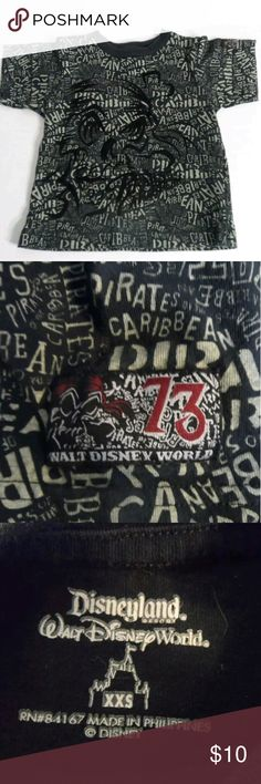 "Boys T-shirt Pirates of the Caribbean Disney XXS Tee features the Pirates of the Caribbean by Disneyland Walt Disney World.  Size is XXS (please pay attention to measurements)  Approx. 15"" long from shoulder to hem. Approx. 13""  wide @ chest from armpit to armpit. Item has been pre-owned; I do not find any stains, rips or odors. ** Coming to you from a smoke-free environment. ?? I have 100% positive feedback on my other selling channel... please see link inside profile. Disney Shirts & Tops…"