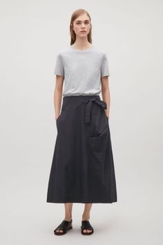 COS image 1 of A-line wrap-over skirt  in Black