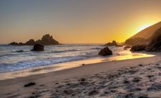 The source for the purple sand at Pfeiffer Beach is large deposits of quartz and manganese garnet originating in the nearby hills being washed down from the creek to its final resting place along the Pacific. (From: Photos: The World's Most Colorful Beaches) Budget Travel