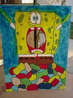 SpongeBob Wet Sponge Toss. Place this game on a tarp. Have the students/children throw as many wet sponges into the opening in one minute. This was very easy to make.