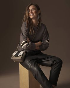 Limited edition top, £39.50, Autograph leather trousers, £199, earrings, £7.50, bag, £25.