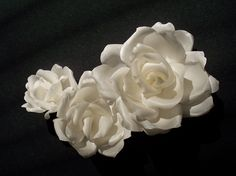Delicate 'Joy' rose blooms custom-made in antique white silk charmeuse. Look beautiful worn as a wedding dress pin at the waist or empire li...