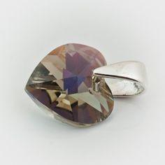 Swarovski Heart Pendant 10mm Black Diamond AB  Dimensions: length: 1,4cm stone size: 10mm Weight ~ 0,72g ( 1 piece ) Metal : sterling silver ( AG-925) Stones: Swarovski Elements 6228 10mm Colour: Black Diamond AB 1 package = 1 piece Price 5.49 PLN