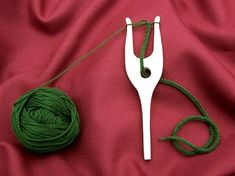 Lucet is a method of cordmaking or braiding which is believed to date back to the Viking and Medieval periods, when it was used to hang useful items from the belt. Lucet cord is square, strong, and slightly springy. Next pages show more textile tools.