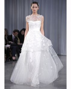 Let your wedding dress take center stage with one of these jaw-dropping ball gowns