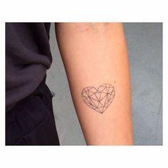 Polygonal heart tattoo on the left inner forearm.