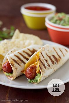 Taco Dogs - Hot dogs go Mexican with these hot dogs that are topped with guacamole and salsa and wrapped in a flour tortilla. Taco Dogs - Hot dogs go Mexican with these hot dogs that are topped with guacamole and salsa and wrapped in a flour tortilla. Dog Recipes, Mexican Food Recipes, Cooking Recipes, Cooking Pork, Cooking Tips, Comida Tex Mex, Hot Dogs, Kids Meals, Easy Meals