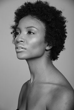 modeltheface:  Carla in black in white.  Photog: Michael Woodward  Side note: It's crazy how much my hair has grown since then! No longer in the twa stage.