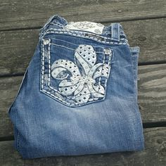 "Miss Me Fleur-de-lis Bling Boot Cut Jeans! Miss Me Fleur-de-lis boot cut Bling jeans. Size 26, inseam 31"". White label on the back! Miss Me Jeans Boot Cut"